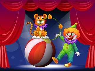 Keuken foto achterwand Beren A tiger and a clown performing at the stage