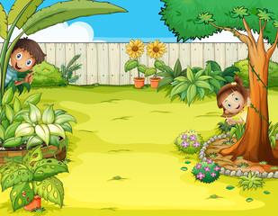 A boy and a girl hiding in the garden