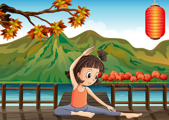 A girl exercising at the bridge with a lantern