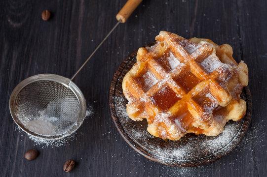 Waffles with honey and powdered sugar