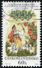stamp shows a shepherd, sheep and green dragon