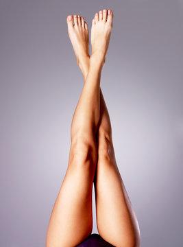 Beautiful long slender female legs after depilation