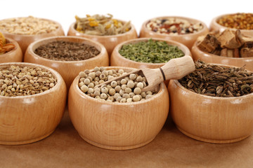 Herbs and spices in small wooden dishes variety bottom of page