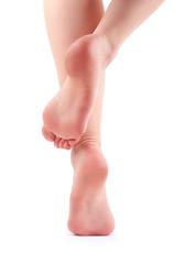 Female feet isolated on white