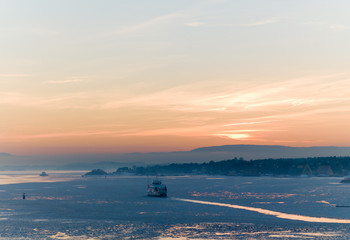 Ferry through the ice in the sunset