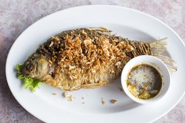 Deep fried java barb fish with garlic