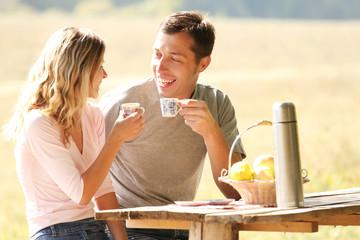 Loving couple on a picnic
