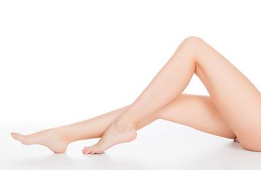 Female legs, white background