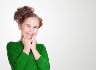 closeup image of a dreaming smiling beautiful little girl