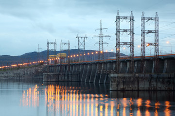 Hydroelectric power station on river at evening