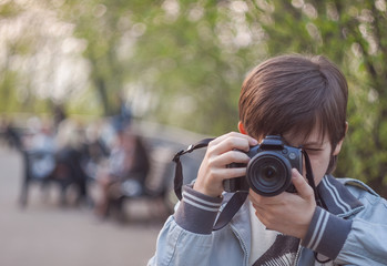 Young photographer clicking photo from camera