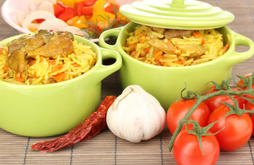 Delicious pilaf with vegetables on table close up