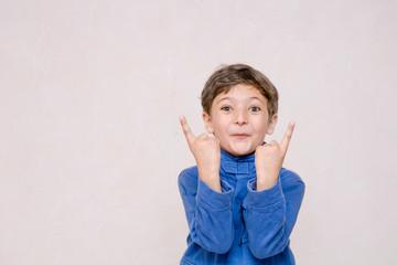 little boy making faces