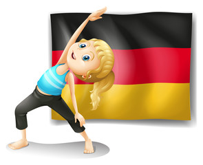 A girl stretching in front of the flag of Germany