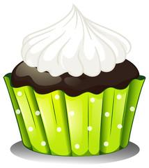 A chocolate cupcake with an icing