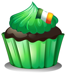 A green cupcake with the flag of Ireland