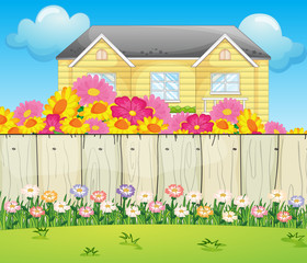 A house surrounded with colorful flowers