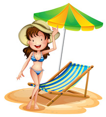 A girl near a foldable beach bed and umbrella