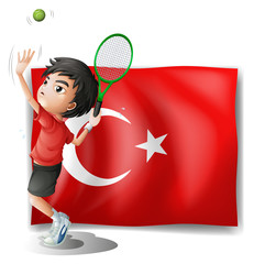 A tennis player in front of the flag of Turkey