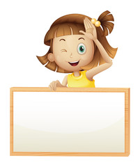 A girl blinking her eye holding an empty board