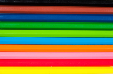 background of rainbow of colorful pencils