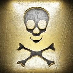golden sign on steel