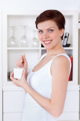beautiful woman eating yogurt as breakfast or snack