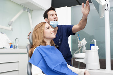 Dentist and patient looking at the monitor