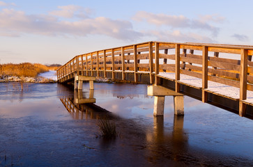 Wall Mural - wooden bridge through frozen river