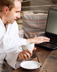 Businessman morning coffee with Laptop email checking