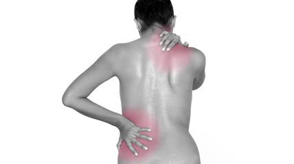 Woman massaging her back