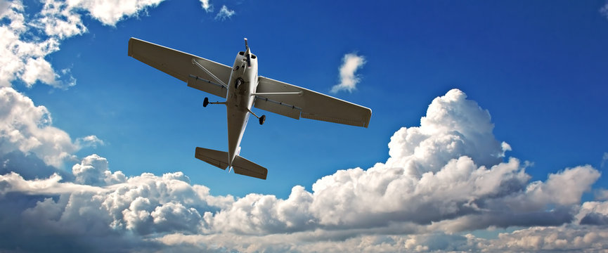 Small light aircraft on training flight