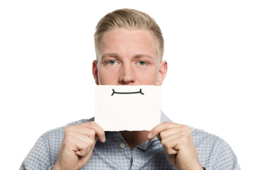 Young businessman presenting blank white card.