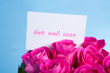 Bouquet of pink roses with get well soon card