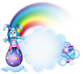 A bunny above the egg near the rainbow