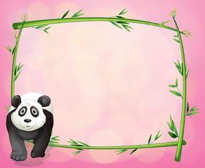 A panda beside a bamboo frame