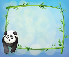 A panda standing beside a bamboo frame
