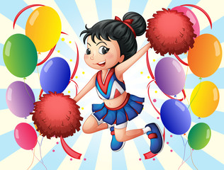 A cheerleader holding red pompoms with balloons