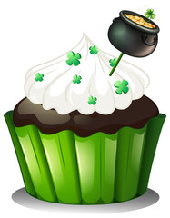 A chocolate cupcake with a pot full of coins