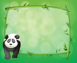 A big panda beside a bamboo frame