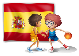 Boys playing basketball with the flag of Spain