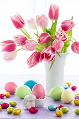 Easter bunny, eggs and tulips
