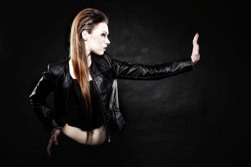 beauty punk girl in leather, subculture stop gesture