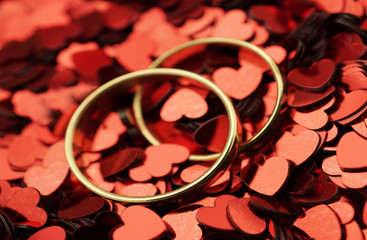 Gold Wedding Rings with small red hearts
