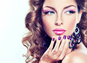 Wall Mural - beautiful model with curly hair and purple manicure