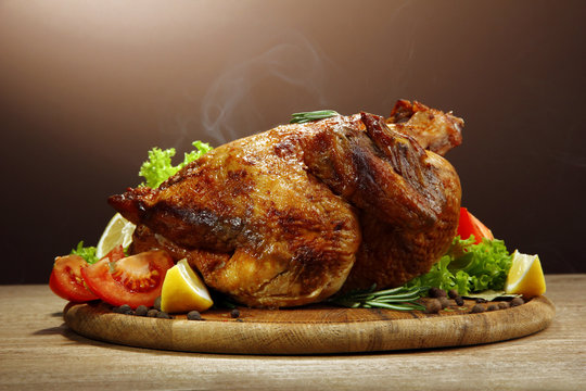 Whole roasted chicken with vegetables,