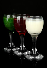 Tasty color liquors, isolated on black