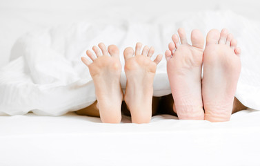 Close up view of two pairs of feet of the couple