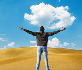 Man standing against beautiful sand dunes - Freedom concept