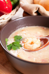 Bowl with shrimp and vegetables soup